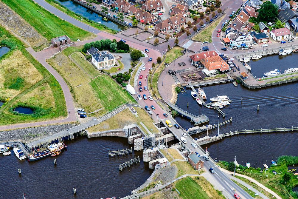 Nederland, Groningen, Gemeente  De Marne, 05-08-2014; Zoutkamp met zeesluis. Voormalig vissersdorp gelegen aan de monding van het Reitdiep in de Lauwerszee, bekend van Heiploeg Garnalen.<br /> Former fishing village, known for Heiploeg Shrimps, port and marina on the Reitdiep, near Lauwers Lake, former Lauwers Sea<br /> <br /> luchtfoto (toeslag op standard tarieven);<br /> aerial photo (additional fee required);<br /> copyright foto/photo Siebe Swart