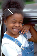 Girl age 5 with a big grin on face at West End Festival.  St Paul  Minnesota USA
