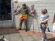 Burry Man, Queensferry. 12 August 2016 Alocal man is covered from head to ankles in burrs and paraded a 7 mile route around the town visiting the community.<br /> Tradition holds that he will bring good luck to the town if they give him whisky and money,  This year he wore a Scottish flag.