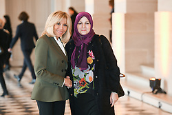 French President's wife Brigitte Macron welcomes Libyan Prime Minister's wife Nadia Reffat as they take part in a spousal event at the Chateau de Versailles in Versailles, near Paris, on November 11, 2018 as part of commemorations marking the 100th anniversary of the 11 November 1918 armistice, ending World War I. Photo By Laurent Zabulon/ABACAPRESS.COM