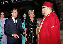 In this photo dated Wednesday, June 14, 2017 Morocco's King Mohammed VI, right, welcomes French President Emmanuel Macron and his wife Brigitte Macron before at tenting an Iftar meal, the evening meal when Muslims end their daily Ramadan fast at sunset, at the King Palace in Rabat, Morocco. The visit is the first by the recently elected French president to a North African country and aims to strengthen the relationship between France and Morocco, including cooperation on security issues. Photo by Abdeljalil Bounhar/Pool/ABACAPRESS.COM