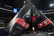 Steven Garlock leads the Iraan High School football team on the field for the second half of the state championship game at AT&T Stadium in Arlington, Texas on December 15, 2016. (Cooper Neill for The New York Times)