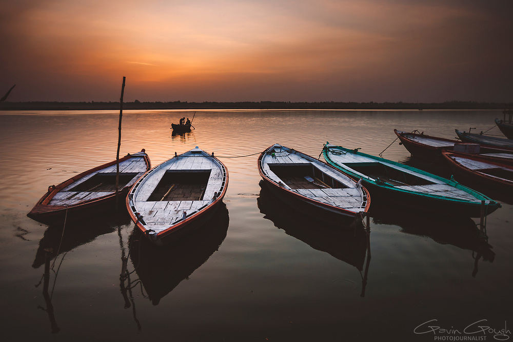 Empty ferryboats moored on the river Ganges at sunrise, River Ganges, Varanasi, India