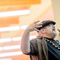 Poet Manuel Gonzales recites a poem to open his performance at the University of New Mexico Zollinger Library in Gallup Thursday.