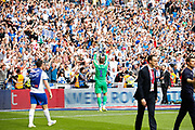 PROMOTED promotion Tranmere Rovers goalkeeper Scott Davies (1) holds the trophy aloft in front of Tranmere Rovers football fans, football supporters after the EFL Sky Bet League 2 Play Off Final match between Newport County and Tranmere Rovers at Wembley Stadium, London, England on 25 May 2019.