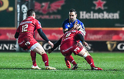 Leinster's Dave Kearney is tackled by Scarlets' Will Boyde<br /> <br /> Photographer Craig Thomas/Replay Images<br /> <br /> Guinness PRO14 Round 17 - Scarlets v Leinster - Friday 9th March 2018 - Parc Y Scarlets - Llanelli<br /> <br /> World Copyright © Replay Images . All rights reserved. info@replayimages.co.uk - http://replayimages.co.uk