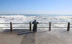 """South Africa - Cape Town - 17 June 2020 - Lady enjoying the seascape and waves crashing Along the Sea Point Promenade soaking up the sunlight, and enjoying the warm day following a few rainy days Picture"""" Brendan Magaar/African News Agency(ANA)"""