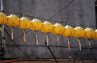 Yellow and red Chinese paper lanterns hang over a city street in Taiwan's capital city, Taipei.