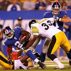 21 Aug, 2010: Pittsburgh Steelers safety Will Allen (26) and running back Isaac Redman (33) tackle New York Giants running back Andre Brown (22) during first half NFL preseason action between the New York Giants and Pittsburgh Steelers at New Meadowlands Stadium in East Rutherford, New Jersey.
