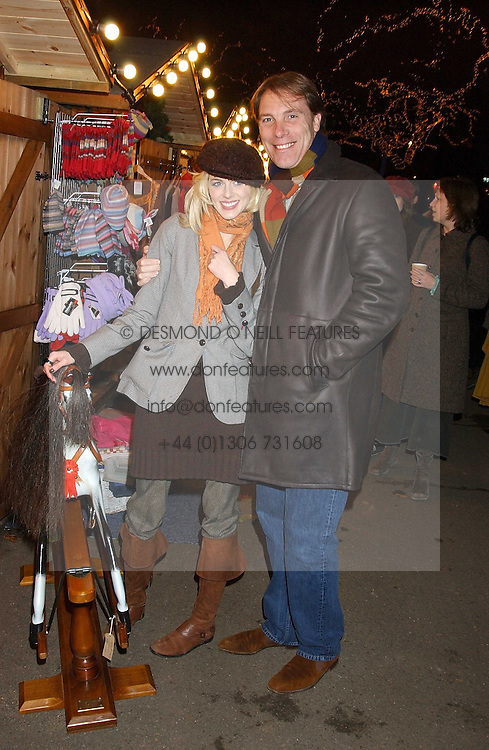 DAMIAN ASPINALL and his wife TV presenter DONNA AIR at the opening of the Natural History Museum's Ice Rink on 16th November 2005.<br /><br />NON EXCLUSIVE - WORLD RIGHTS
