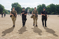 "Soldiers join police officers on Horse Guards Parade in Westminster, London, as armed troops have been deployed to guard ""key locations"" under Operation Temperer, which is being enacted after security experts warned the Government that another terrorist attack could be imminent."