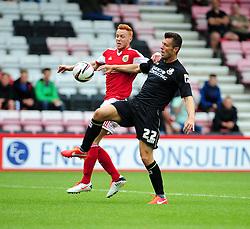 Bristol City's Ryan Taylor jostles for the ball with Bournemouth's Elliot Ward - Photo mandatory by-line: Dougie Allward/JMP - Tel: Mobile: 07966 386802 27/03/2013 - SPORT - FOOTBALL - Goldsands Stadium - Bournemouth -  Bournemouth V Bristol City - Pre Season friendly