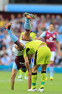 Rudy Gestede of Aston Villa (l) tumbles over Will Vaulks of Rotherham Utd. EFL Skybet championship match, Aston Villa v Rotherham Utd at Villa Park in Birmingham, The Midlands on Saturday 13th August 2016.<br /> pic by Andrew Orchard, Andrew Orchard sports photography.