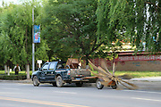 PINGLIANG, CHINA - JUNE 14: (CHINA OUT) <br /> <br /> A sweeping vehicle with nine brooms rotating sweeps the road on June 14, 2016 in Pingliang, Gansu Province of China. The sweeping vehicle was made up of a green truck and nine rotating brooms with two wheels in Pingliang, Gansu Province of China. Nine rotating brooms swept following the green truck. <br /> ©Exclusivepix Media