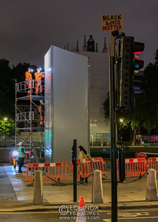 London, United Kingdom - 12 June 2020<br /> Winston Churchill statue being covered in protective scaffolding and sheet metal following Black Lives Matter protests, Parliament Square, London, England, UK.<br /> (photo by: EQUINOXFEATURES.COM)<br /> Picture Data:<br /> Photographer: Equinox Features<br /> Copyright: ©2020 Equinox Licensing Ltd. +443700 780000<br /> Contact: Equinox Features<br /> Date Taken: 20200612<br /> Time Taken: 015942<br /> www.newspics.com