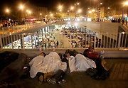 Refugees sleep outside the Keleti train station in Budapest, Hungary, September 2, 2015. An estimated 3,000 people are now believed to be camped out at the station as authorities continue to block those without European visas or travel documents from boarding trains.