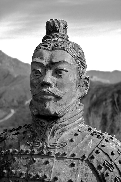 this is a very large metal statue of a warrior on the Great Wall of China near Bejing