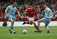 Photo: Ian Hebden.<br />Nottingham Forest v Chesterfield. Coca Cola League 1. 02/09/2006.<br />Forest's Grant Holt (C) bursts through Chesterfield's Mark Allott (L) and Aaron Downes.