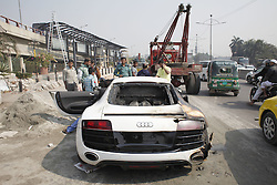 January 13, 2017 - Dhaka, Bangladesh - An Audi R8 engulfed in flames on the side of a busy road in Dhaka, Bangladesh. January 13, 2017.  Not sure exactly what happened here, but looks like the engine compartment caught fire. (Credit Image: © Suvra Kanti Das via ZUMA Wire)