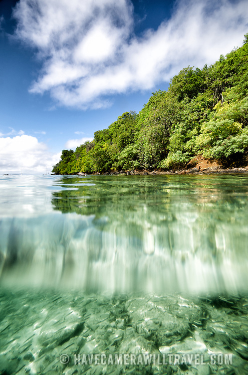 A split shot showing below and above the water at Maho Bay on St John in the US Virgin Islands.