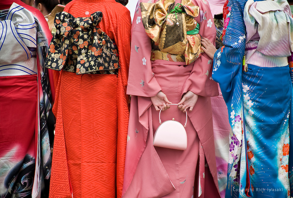Women wearing colorful kimonos gather in a group during a visit to Kumamoto Castle, Kumamoto city, Kumamoto Prefecture, Japan