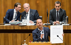 "16.05.2017, Parlament, Wien, AUT, Parlament, Nationalratssitzung, Sitzung des Nationalrates mit einer Erklärung des Bundeskanzler zur Regierungskrise und Neuwahlen, im Bild Klubobmann NEOS Matthias Strolz mit ""Pakt der Verantwortung"" vor Bundesminister für europaeische und internationale Angelegenheiten Sebastian Kurz (ÖVP), Bundesminister für Justiz Wolfgang Brandstetter (ÖVP) und Bundeskanzler Christian Kern (SPÖ) // Leader of the Parliamentary Group NEOS Matthias Strolz in front of Austrian Foreign Minister Sebastian Kurz, Austrian Minister of Justice Wolfgang Brandstetter and Federal Chancellor of Austria Christian Kern during meeting of the National Council of austria with a speech of the federal chancellor regarding to government crisis and new elections at austrian parliament in Vienna, Austria on 2017/05/16, EXPA Pictures © 2017, PhotoCredit: EXPA/ Michael Gruber"