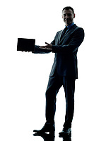 one caucasian business man standing showing digital tablet  silhouette isolated on white background