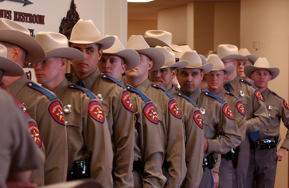 Austin, Texas September 5, 2003:  The new cadet class of the Department of Public Safety (DPS) receive their commission in a ceremony Friday which adds 160 troopers to  Texas' state police force.  DPS officers are the most visible of Texas' crimefighters and patrol the state's thousands of miles of highways. ©Bob Daemmrich