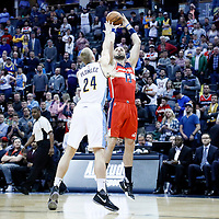 08 March 2017: Washington Wizards center Marcin Gortat (13) takes a jump shot against Denver Nuggets center Mason Plumlee (24) during the Washington Wizards 123-113 victory over the Denver Nuggets, at the Pepsi Center, Denver, Colorado, USA.