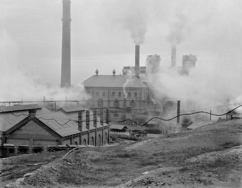 Buildings and Smokestack, Ashington Coal Mines, England, 1928