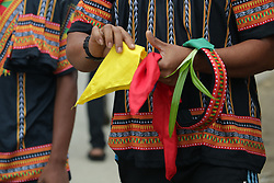 August 13, 2017 - Blangkejeren, Aceh, Indonesia - A dancer holds a teleng and tajuk (Pandan leaves) before participating in a mass Saman dance at 1000 Bukit Stadium, Gayo Lues District, Aceh Province, Indonesia. (Credit Image: © Abdul Hadi Firsawan/Pacific Press via ZUMA Wire)