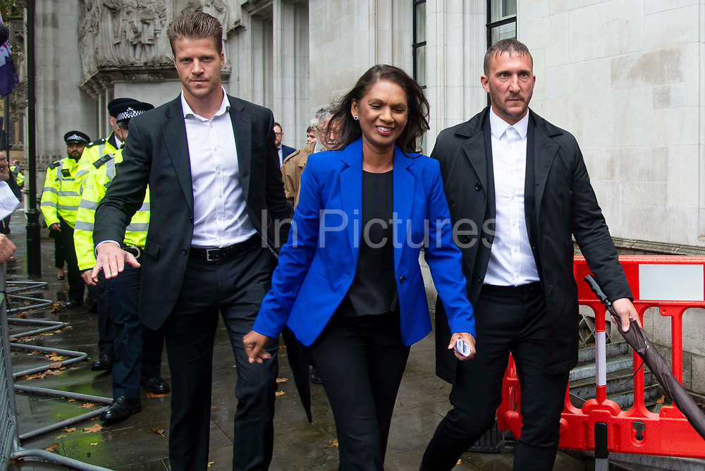 Businesswoman and campaigner Gina Miller, C who launched legal proceedings against Prime Minister Boris Johnsons government over the suspension of parliament smiles outside the Supreme Court after a ruling that the prorogation of Parliament was unlawful on 24th September 2019 in London, United Kingdom. The Supreme Court  ruled that Prime Minster Boris Johnson acted unlawfully when he requested that the Queen prorogue parliament for more than a month, and that lawmakers should reconvene as soon as possible.