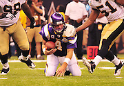 Minnesota Vikings  QB (4) Brett Favre tries to strong arm New Orleans Saints DT Sedrick Ellis (98) , Ellis grabs his jersey and gets him on the ground. The Saints go on to win 14-9 at the Super Dome in the NFL Season Opener in Louisiana Thursday Sept 9,2010. PHOTO©SuziAltman.com