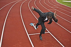 Oct. 11, 2009 - businessman sprinting on running track. Model and Property Released (MR&PR) (Credit Image: © Cultura/ZUMAPRESS.com)