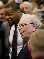 Berkshire Hathaway CEO Warren Buffett watches a newspaper tossing contest with Miami Dolphins defensive tackle Ndamukong Suh (L) before the Berkshire Hathaway annual meeting in Omaha, Nebraska, U.S. May 6, 2017. REUTERS/Rick Wilking