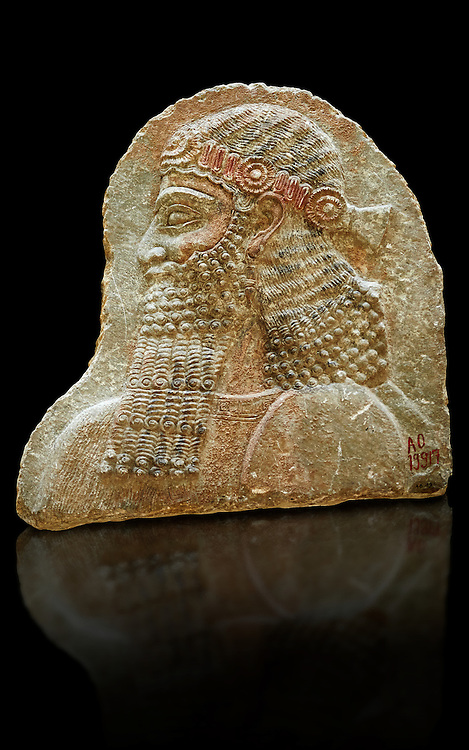 Stone relief sculptured panel of a man. From the facade of the throne room,  Inv AO 19917 from Dur Sharrukin the palace of Assyrian king Sargon II at Khorsabad, 713-706 BC.  Louvre Museum Room 4 , Paris .<br /> <br /> If you prefer to buy from our ALAMY PHOTO LIBRARY  Collection visit : https://www.alamy.com/portfolio/paul-williams-funkystock/ancient-assyria-antiquities.html  Refine search by adding background colour, place, subject, museum etc into the LOWER SEARCH WITHIN GALLERY box to <br /> <br /> Visit our ANCIENT ASSYRIAN PHOTO COLLECTIONS for more photos to download or buy as wall art prints https://funkystock.photoshelter.com/gallery-collection/Ancient-Assyrian-Art-Artefacts-Antiquities-Historic-Sites-Pictures-Images-of/C0000cjRqQyJjLag