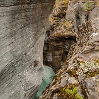 The Mistaya river flows through a a narrow eroded slot at Mistaya Canyon.