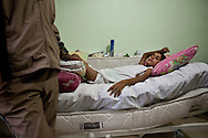 12 year old Saleh from Idlib province in northern Syria, lays paralysed from the waist down in Dar Istishfah care centre. Schrapnel entered his spine when the Syrian airforce bombed his neighbourhood. Reyhanli, Turkey. 7/12/2012