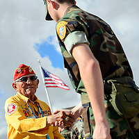 081414  Adron Gardner<br /> <br /> U.S. Marine Corps Code Talker John Kinsel shakes hands with a Young Marine during Code Talker day in Window Rock Thursday.