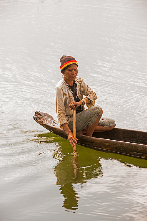 Paddling on Lake Sebu, Phillipines <br /> <br /> Lake Sebu is a first class municipality in the province of South Cotabato, Philippines. The placid lake of Lake Sebu can be found in Allah Valley near the municipality of Surallah, South Cotabato. Surrounded by rolling hills and mountains covered with thick rain forest, the lake has an area of 354 hectares (870 acres), with an elevation of approximately 1,000 metres (3,300 ft).