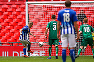 Goal Chertsey Town's Jake Baxter (9) scores from the penalty spot 2-1 during the FA Vase final match between Chertsey Town and Cray Valley at Wembley Stadium, London, England on 19 May 2019.