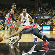 ORLANDO, FL - NOVEMBER 15: Brandon Miller #14 of the Gardner Webb Runnin Bulldogs dives for a loose ball in front of Terrell Allen #2 of the UCF Knights during a NCAA basketball game at the CFE Arena on November 15, 2017 in Orlando, Florida. (Photo by Alex Menendez/Getty Images) *** Local Caption *** Brandon Miller; Terrell Allen