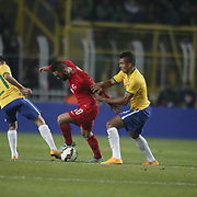 Turkey's Bekir Irtegun (L) and Brazil's Filipe Luis (R) during their a international friendly soccer match Turkey betwen Brazil at Sukru Saracoglu Arena in istanbul November 12, 2014. Photo by Aykut AKICI/TURKPIX