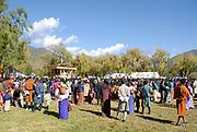 Crowds of Bhutanese in national dress watching the events at the Paro festival. Paro, Bhutan. Druk Yul. 11 November 2007