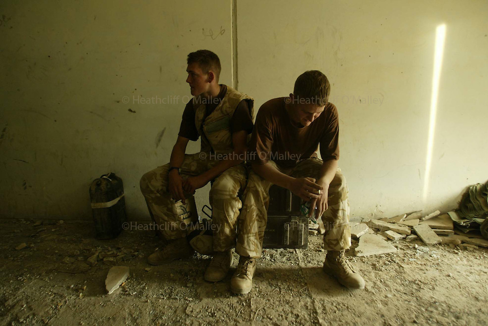 Soldiers from .Bravo Company,the Black Watch at a foward operating base near Camp Dogwood,in position to monitor movements to and from the embattled city of Falluja.pic shows Pvt's Alex McConnachie and Sheldon Hird taking a brief respite after another long day in hostile central Iraqi territory.