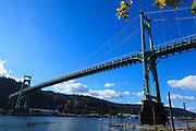 USA, Oregon, Portland, Cathedral Park, boat passing under St. John's Bridge.