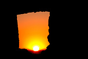 The sun rises through a hole in the ancient Merinide Ruins over Fes, Morocco on Saturday morning, June 02, 2007. (PHOTO BY TIMOTHY D. BURDICK)