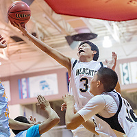 022114      Cable Hoover<br /> <br /> Chinle Wildcat Jimican Ranger (3) reaches a layup past the Alchesay Falcons Friday at Monument Valley High School.