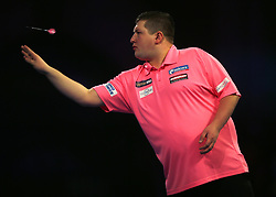Keegan Brown throws during his match against Karel Sedlacek during day three of the William Hill World Darts Championships at Alexandra Palace, London.