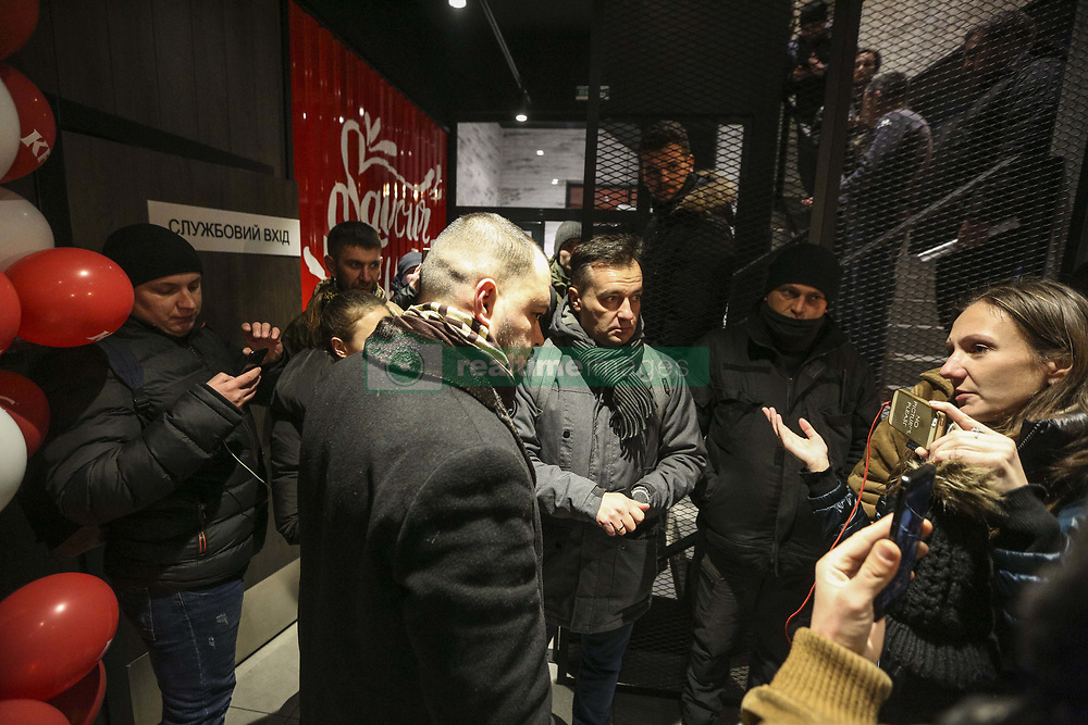 November 22, 2018 - Kiev, Ukraine - Activists talks to representative of the owner of KFC franchise as they block the restaurant in Kyiv, Ukraine, November 22, 2018. Participants of EuroMaydan block KFC fast food restaurant, opened a day earlier in a building of the House of Trade Unions, where dozens of protesters were burned alive in 2014 during the Revolution of Dignity. (Credit Image: © Sergii Kharchenko/NurPhoto via ZUMA Press)